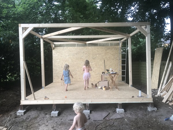 My kids inspecting the back wall