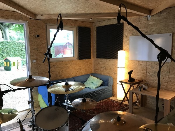 Seen from the position of the drummer (notice the whiteboard looking infrared heater on the wall)