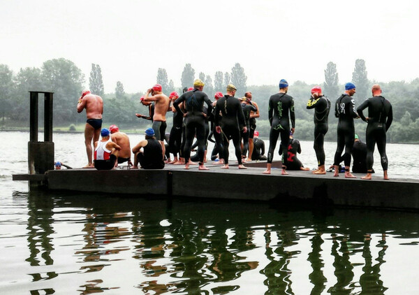A rather small group of motivated swimmers ready to go