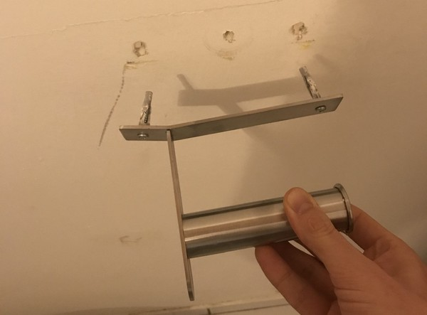 The IKEA toilet paper holder got bent by the back of my head and torn out of the wall