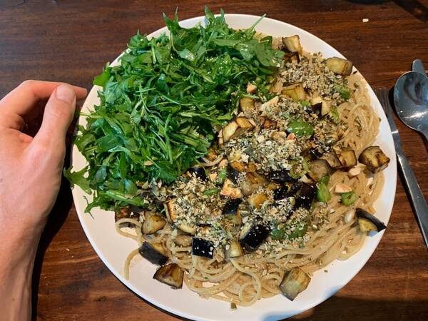 It's a relief that pasta is without animal products by default – rocket, eggplant, roasted cashews on top and it makes for great carbo-loading