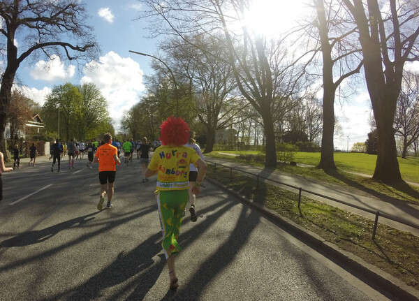 This guy is not only running barefoot, but also dressed as German children's cartoon character Pumuckl