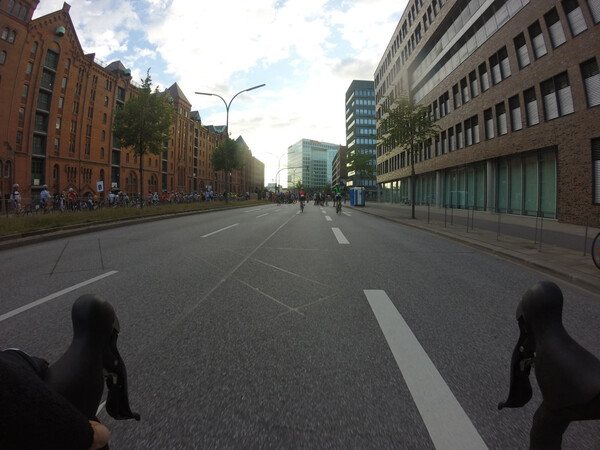 Almost there, cyclists roaming the otherwise empty streets